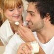 Mfeeding his girlfriend yogurt — Stock Photo #7946512
