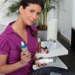 Portrait of a woman with cosmetics — Stock Photo
