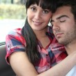 Couple sitting in the back of a car — Stock Photo #7946629