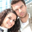 Couple stood outside high-rise building — Stock Photo #7946885