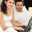 Couple relaxing in bed on Sunday morning — Stock Photo #7946900
