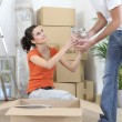 Stock Photo: Couple unpacking belongings