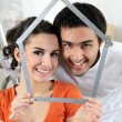 Stock Photo: Couple making house shape