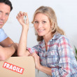 A couple moving in a new house. — Stock Photo