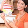 Portrait of a woman at breakfast — Stock Photo