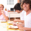 Portrait of three friends at table — Stock Photo #7948025