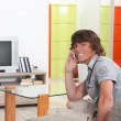 Young man on a call in his living room — Stock Photo #7948117