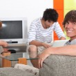 Stock Photo: Three lads relaxing at home