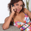 Young woman on the phone - Foto Stock