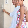 Portrait of a couple at door — Stock Photo