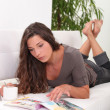 Young woman relaxing on the sofa — Stock Photo