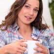 Stock Photo: Womwith hot drink