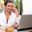 Modern businessman having breakfast at home — Stock Photo #7948701