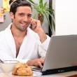 Modern businessman having breakfast at home — Stock Photo
