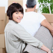 Couple carrying rug — Stock Photo