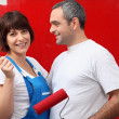 Couple painting a room bright red — Stock Photo #7949220