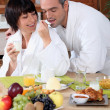 Couple having breakfast at home — Stock Photo #7949336