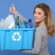 Woman recycling empty bottles — Stock Photo