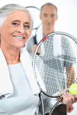 Couple playing tennis together — Stock Photo