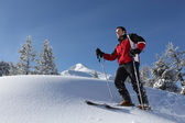 Man skiing on a sunny day — Stock Photo