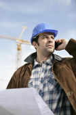 Foreman with a laptop and phone — Stock Photo