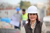 Woman working on a construction site — Stok fotoğraf