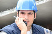 Builder on walkie talkie — Stock Photo