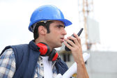 A foreman giving instructions through his cb. — Stock Photo