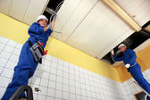Two electricians working in a building — Stock Photo