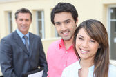 Young couple and real estate promoter — Stock Photo
