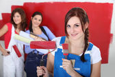 Women painting a room red — Stock Photo