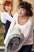Mother helping her daughter on moving day — Stock Photo