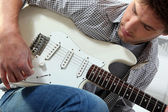 Young man with an electric guitar — Stock Photo