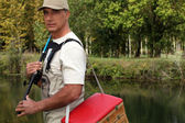 Man with his fishing gear — Stock Photo