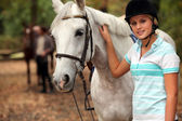 Blond teenager next to horse — Stock Photo