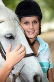 Blond teenage horse rider — Stock Photo