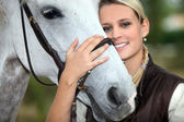 Woman and horse — Stock Photo