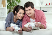 Young couple playing video games together — Stock Photo