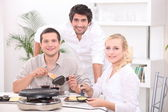Friends eating raclette — Stock Photo
