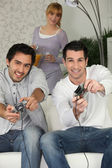 Men playing video games — Stock Photo
