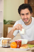 Man eating breakfast alone — Stock Photo