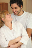 In-love couple in kitchen — Stock Photo