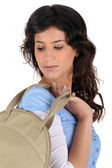 Portrait of a young woman with handbag — Stock Photo