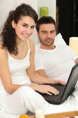 Couple relaxing in bed on Sunday morning — Stock Photo