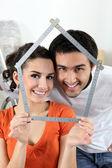 Couple making house shape — Stock Photo