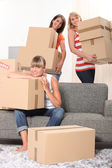Girls carrying boxes — Stock Photo