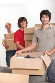 Young men moving boxes — Stock Photo