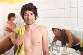Three male house mates sharing bathroom — Stock Photo