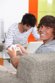 Housemates playing video games — Stock Photo