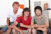 Roommates drinking beer — Stock Photo
